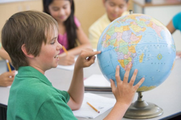 Image of a child using a globe.
